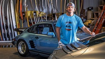 Robby Naish next to his 911 Carrera S (Type 991) and 911 S from 1977