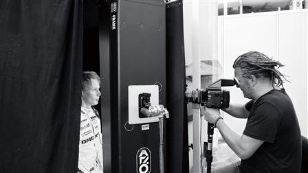 Porsche Photographer Martin Schoeller (right) takes photos of Brandon Hartley (left)